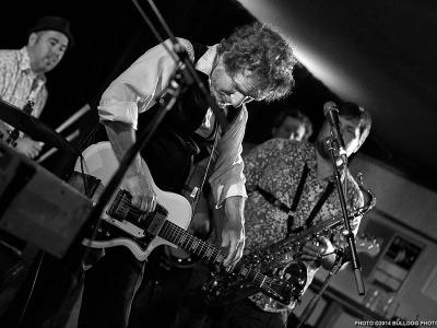 Drew Nelson on stage. Photo ©2014 Bulldog Photography